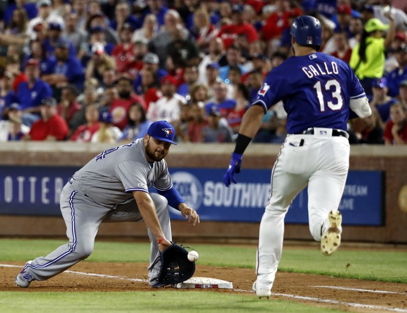 Toronto Blue Jays first baseman Rowdy Tellez reaches for the throw to the bag for the out against Texas Rangers' Joey Gallo (13) during the fourth inning of a baseball game in Arlington, Texas, Saturday, May 4, 2019. Gallo was out on a ground ball to relief pitcher Derek Law. (AP Photo/Tony Gutierrez)