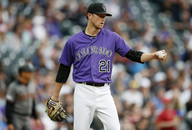 Colorado Rockies starting pitcher Kyle Freeland reacts after giving up a solo home run to Arizona Diamondbacks' Carson Kelly in the second inning of a baseball game Saturday, May 4, 2019, in Denver. (AP Photo/David Zalubowski)