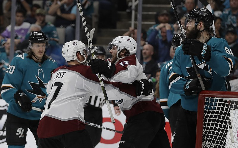 Colorado Avalanche forward Tyson Jost (17) celebrates with Alexander Kerfoot (13) after scoring a goal against the San Jose Sharks during the second period of Game 5 of an NHL hockey second-round playoff series Saturday, May 4, 2019, in San Jose, Calif. (AP Photo/Ben Margot)