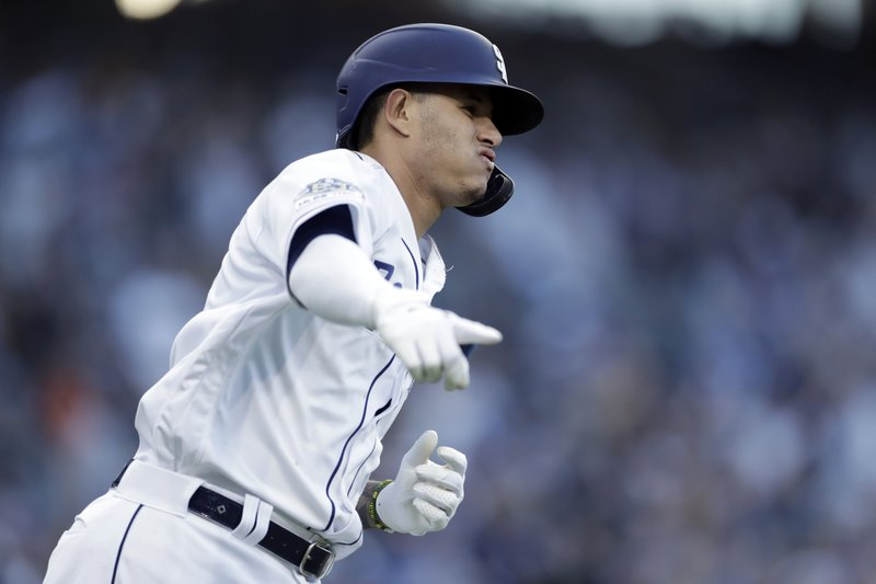 The San Diego Padres' Manny Machado runs the bases after hitting a home run during the third inning of a baseball game against the Los Angeles Dodgers, Saturday, May 4, 2019, in San Diego. (AP Photo/Gregory Bull)