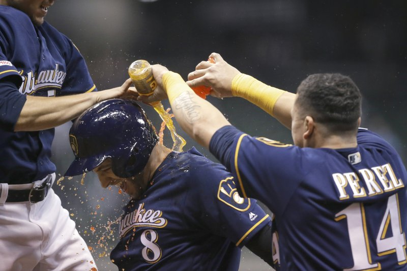 Milwaukee Brewers' Ryan Braun is doused by teammates after his game-winning, two-run single against the New York Mets during the 18th inning of a baseball game Saturday, May 4, 2019, in Milwaukee. (AP Photo/Jeffrey Phelps)