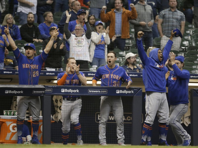 The team bench reacts to New York Mets' Jeff McNeil RBI single against the Milwaukee Brewers during the 18th inning of a baseball game Saturday, May 4, 2019, in Milwaukee. (AP Photo/Jeffrey Phelps)
