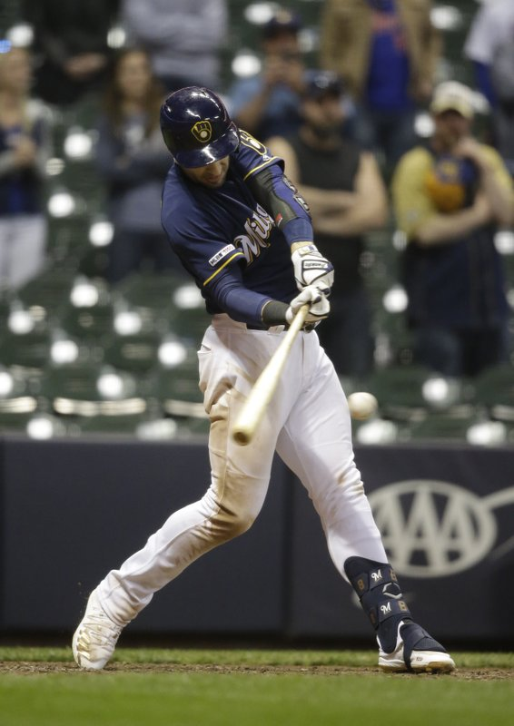 Milwaukee Brewers' Ryan Braun hits a game-winning two-run single against the New York Mets during the 18th inning of a baseball game Saturday, May 4, 2019, in Milwaukee. The Brewers won 4-3. (AP Photo/Jeffrey Phelps)