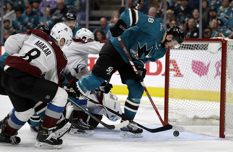 San Jose Sharks' Tomas Hertl, right, scores a goal in front of Colorado Avalanche defenseman Cale Makar (8) during the third period of Game 5 of an NHL hockey second-round playoff series Saturday, May 4, 2019, in San Jose, Calif. (AP Photo/Ben Margot)