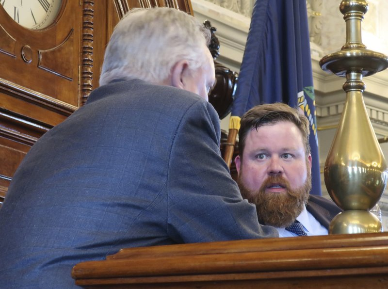 Kansas House Speaker Pro Tem Blaine Finch, right, R-Ottawa, confers with Rep. Don Hineman, R-Dighton, before a House vote on a proposed state budget at the Statehouse, Saturday, May 4, 2019, in Topeka, Kan. Hineman and other moderates had worked with Democrats to block the budget in hopes of forcing a debate on Medicaid expansion but enough of them gave up the effort for the spending blueprint to pass. (AP Photo/John Hanna)
