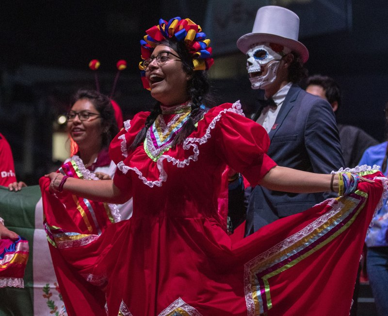 In this Thursday, April 25, 2019 photo, Participants from Mexico, dressed in intricate costumes, entered Freedom Hall during the Parade of Nations to begin the VEX World Robotics Championships in Louisville Ky. (Michelle Hutchins/Courier Journal via AP)