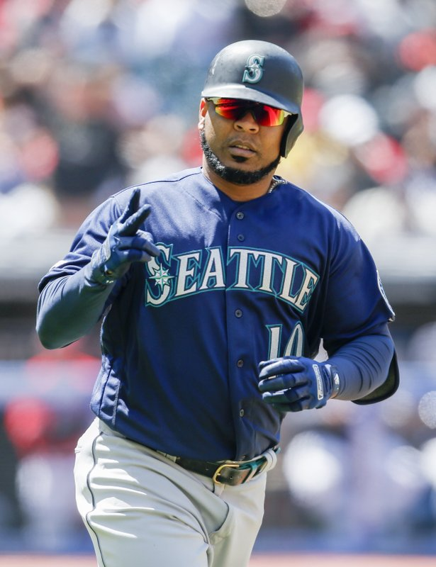 Seattle Mariners' Edwin Encarnacion rounds the bases after hitting a two run home run off Cleveland Indians relief pitcher Dan Otero during the fourth inning of a baseball game, Sunday, May 5, 2019, in Cleveland. (AP Photo/Ron Schwane)