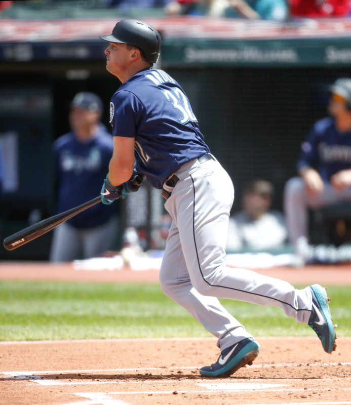Seattle Mariners' Jay Bruce hits a grand slam off Cleveland Indians starting pitcher Cody Anderson during the first inning of a baseball game, Sunday, May 5, 2019, in Cleveland. (AP Photo/Ron Schwane)