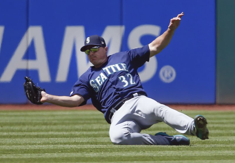 Seattle Mariners' Jay Bruce makes a sliding catch to get out Cleveland Indians' Tyler Naquin during the third inning of a baseball game, Sunday, May 5, 2019, in Cleveland. (AP Photo/Ron Schwane)