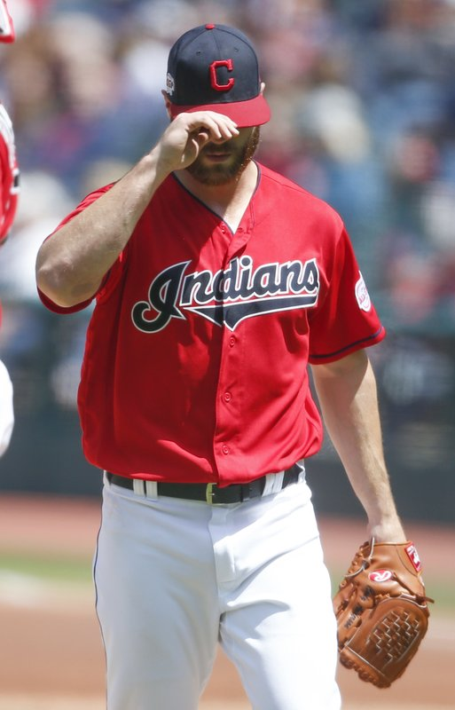 Cleveland Indians starting pitcher Cody Anderson walks back to the dugout after being pulled during the first inning of a baseball game against the Seattle Mariners, Sunday, May 5, 2019, in Cleveland. (AP Photo/Ron Schwane)