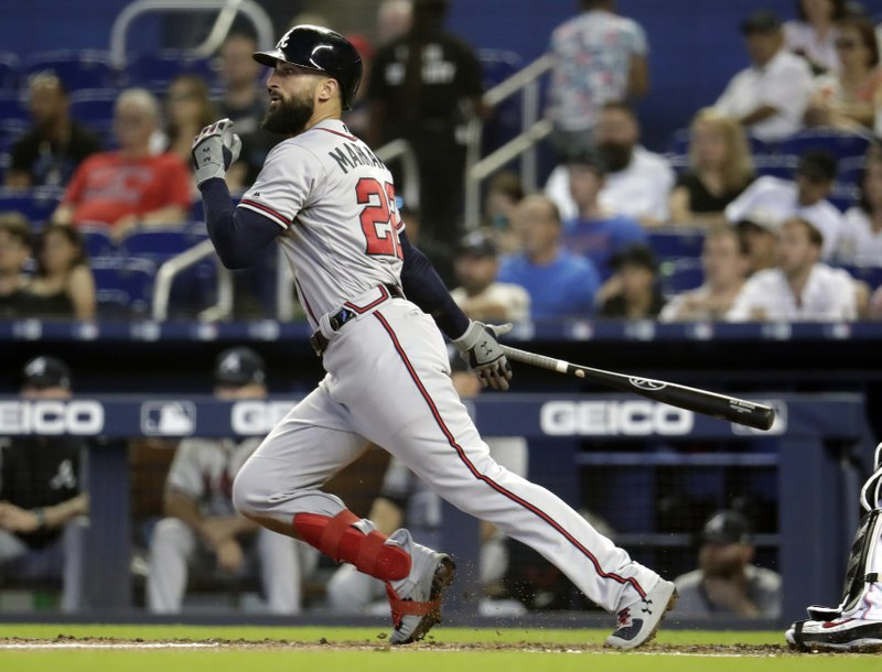 Atlanta Braves' Nick Markakis watches after hitting a single during the third inning of a baseball game against the Miami Marlins, Sunday, May 5, 2019, in Miami. (AP Photo/Lynne Sladky)