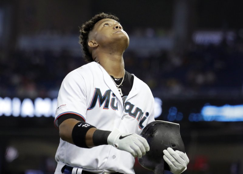 Miami Marlins' Starlin Castro walks to the dugout after grounding out during the fourth inning of a baseball game against the Atlanta Braves, Sunday, May 5, 2019, in Miami. (AP Photo/Lynne Sladky)