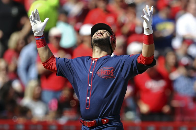 Cincinnati Reds' Eugenio Suarez reacts after hitting a two-run home run in the first inning of a baseball game against the San Francisco Giants, Sunday, May 5, 2019, in Cincinnati. (AP Photo/Aaron Doster)