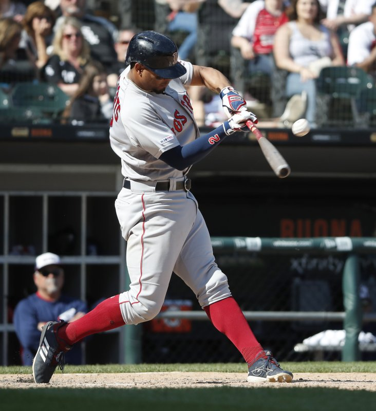 Boston Red Sox's Xander Bogaerts hits a grand slam against the Chicago White Sox during the eighth inning of a baseball game in Chicago, Sunday, May 5, 2019. (AP Photo/Jeff Haynes)