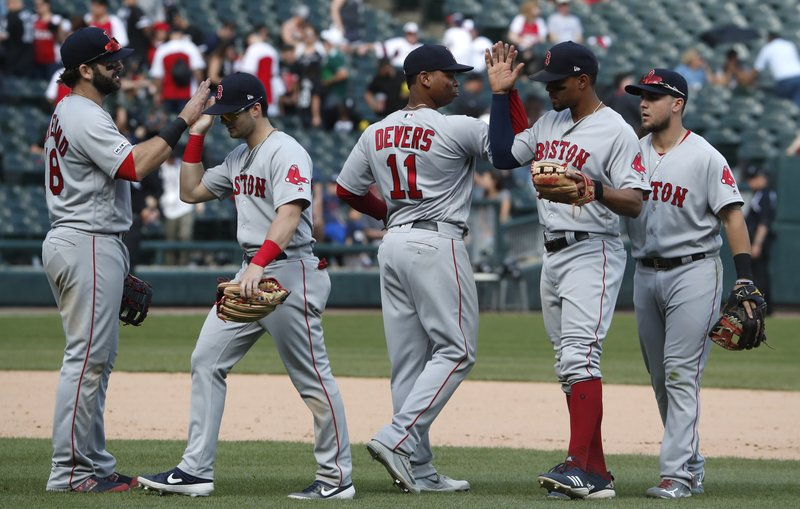 The Boston Red Sox celebrate after defeating the Chicago White Sox in a baseball game in Chicago, Sunday, May 5, 2019. (AP Photo/Jeff Haynes)