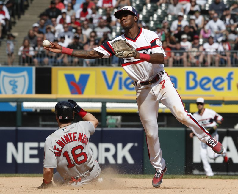 Chicago White Sox shortstop Tim Anderson (7) forces out Boston Red Sox's Andrew Benintendi (16) then throws to first to complete a double play during the seventh inning of a baseball game in Chicago Sunday, May 5, 2019. (AP Photo/Jeff Haynes)