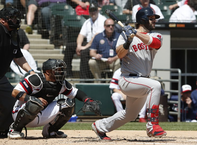 Boston Red Sox's Mitch Moreland, right, watches his RBI single in front of Chicago White Sox catcher Welington Castillo during the second inning of a baseball game in Chicago Sunday, May 5, 2019. (AP Photo/Jeff Haynes)