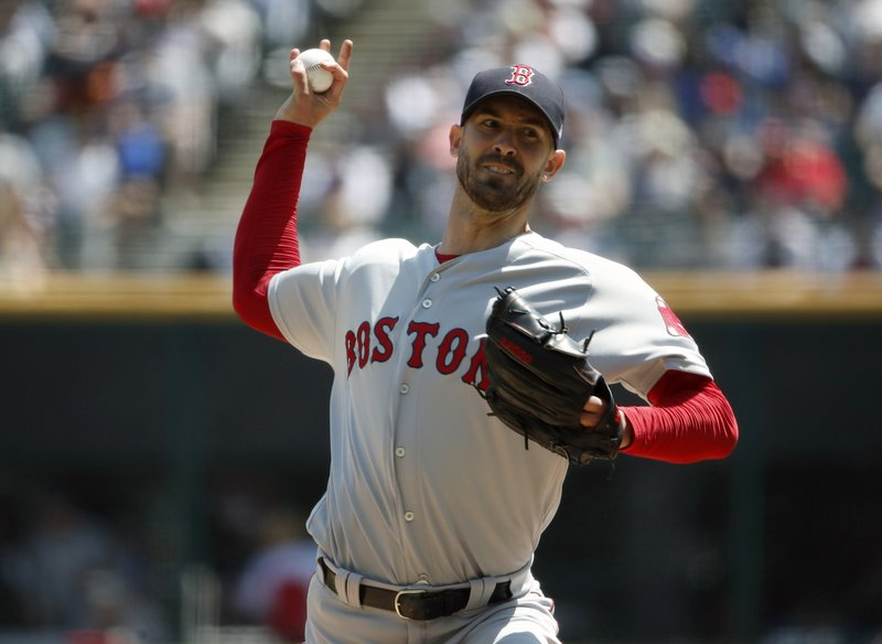 Boston Red Sox starting pitcher Rick Porcello delivers during the first inning of a baseball game against the Chicago White in Chicago, Sunday, May 5, 2019. (AP Photo/Jeff Haynes)