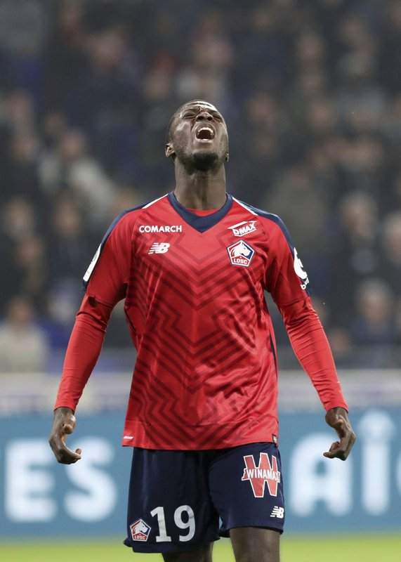 Lille's Nicolas Pepe reacts during a French League One soccer match against Lyon in Decines, near Lyon, central France, Sunday, May 5, 2019. (AP Photo/Laurent Cipriani)