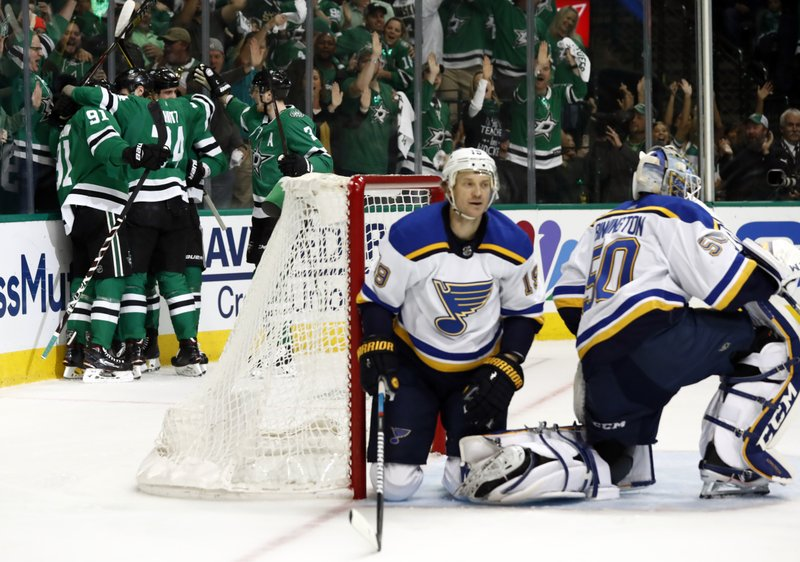Teammates congratulate Dallas Stars' Tyler Seguin (91) on his goal as St. Louis Blues goaltender Jordan Binnington (50) and Jay Bouwmeester (19) kneel in front of the net during the first period in Game 6 of an NHL second-round hockey playoff series, Sunday, May 5, 2019, in Dallas. (AP Photo/Tony Gutierrez)