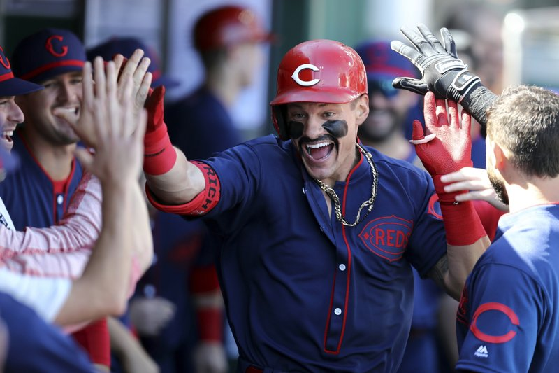 Cincinnati Reds' Derek Dietrich celebrates with teammates after hitting a solo home run in the first inning of a baseball game against the San Francisco Giants, Sunday, May 5, 2019, in Cincinnati. (AP Photo/Aaron Doster)