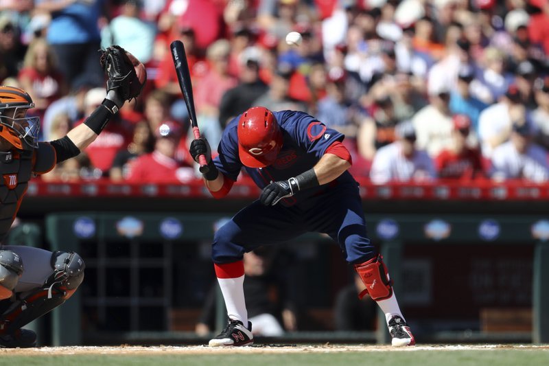 San Francisco Giants catcher Buster Posey, left, reaches for a pitch thrown over Cincinnati Reds' Jose Peraza in the first inning of a baseball game, Sunday, May 5, 2019, in Cincinnati. (AP Photo/Aaron Doster)