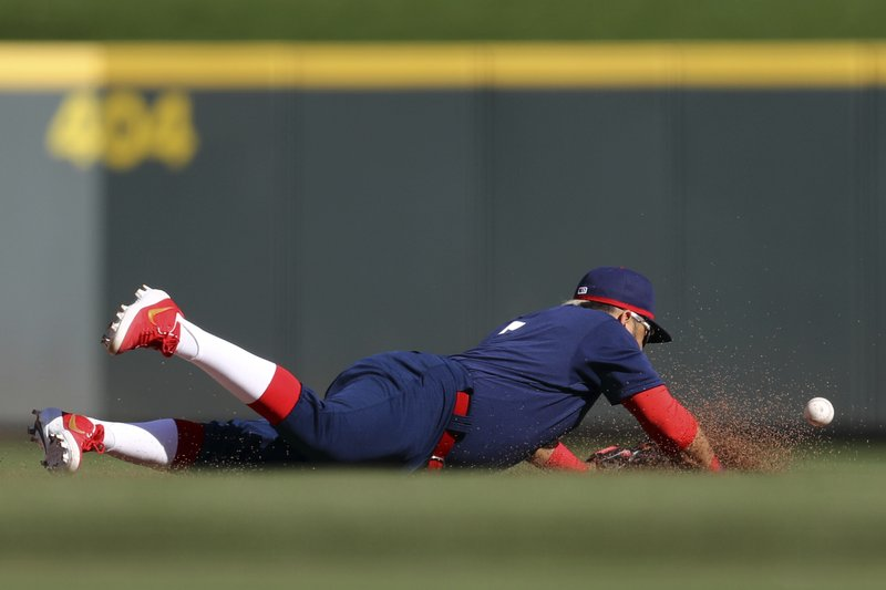 Cincinnati Reds' Eugenio Suarez dives but is unable to field a ball hit for a single by San Francisco Giants' Steven Duggar in the sixth inning of a baseball game, Sunday, May 5, 2019, in Cincinnati. (AP Photo/Aaron Doster)