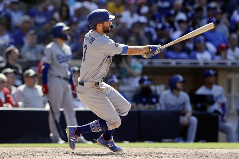 The Los Angeles Dodgers' Chris Taylor watches his two-run home run hit during the eighth inning of a baseball game against the San Diego Padres, Sunday, May 5, 2019, in San Diego. (AP Photo/Gregory Bull)