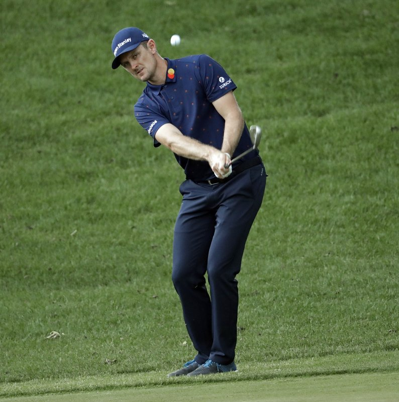 Justin Rose, of England, chips to the 15th green during the final round of the Wells Fargo Championship golf tournament at Quail Hollow Club in Charlotte, N.C., Sunday, May 5, 2019. (AP Photo/Chuck Burton)