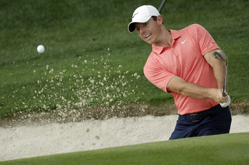 Rory McIlroy, of Northern Ireland, hits from a sand trap on the 15th hole during the final round of the Wells Fargo Championship golf tournament at Quail Hollow Club in Charlotte, N.C., Sunday, May 5, 2019. (AP Photo/Chuck Burton)