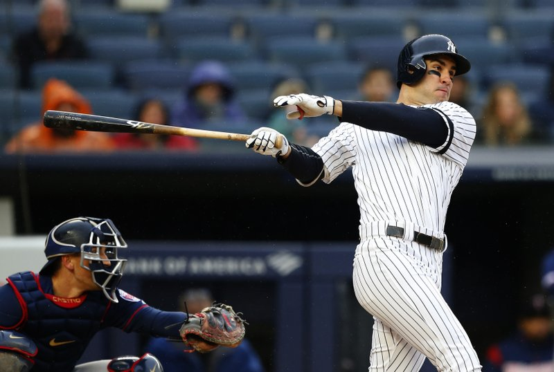 New York Yankees' Mike Tauchman follows through on a two run home run against the Minnesota Twins in the fourth inning of a baseball game Sunday, May 5, 2019, in New York. (AP Photo/Noah K. Murray)