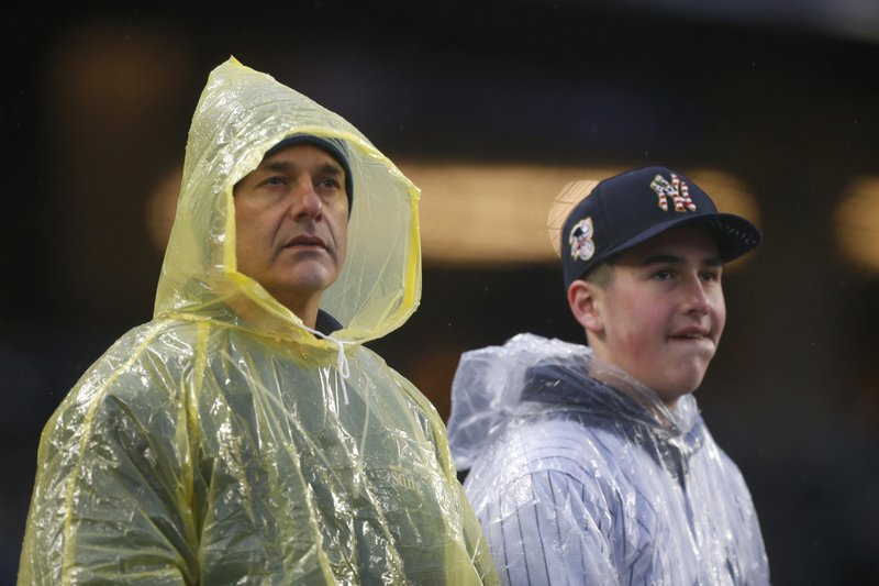 New York Yankees fans watch the seventh inning of a baseball game against the Minnesota Twins, Sunday, May 5, 2019, in New York. (AP Photo/Noah K. Murray)