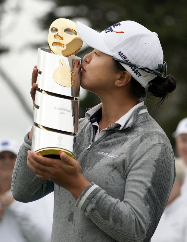 Kim Sei-young, of South Korea, kisses her trophy on 18th green of the Lake Merced Golf Club after winning the LPGA Mediheal Championship golf tournament Sunday, May 5, 2019, in Daly City, Calif. (AP Photo/Tony Avelar)
