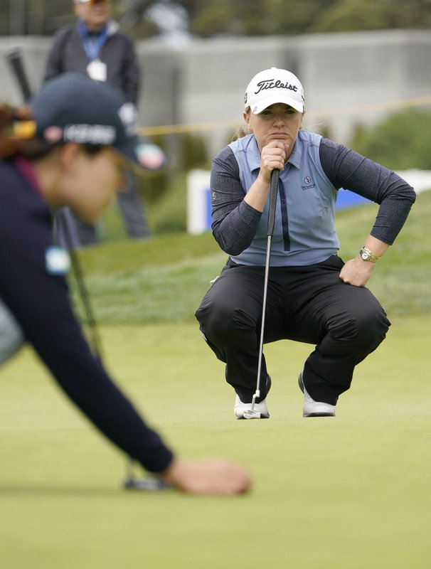Bronte Law, right, of England, waits for In Gee Chun, left, of South Korea, to set up her putt on the 17th green of the Lake Merced Golf Club during the final round of the LPGA Mediheal Championship golf tournament Sunday, May 5, 2019, in Daly City, Calif. (AP Photo/Tony Avelar)