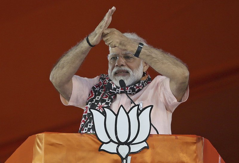 FILE - In this April 1, 2019, file photo, Indian Prime Minister Narendra Modi gestures as he speaks during an election campaign rally of his Bharatiya Janata Party (BJP) in Hyderabad, India. (AP Photo/Mahesh Kumar A., File)