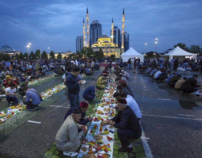 FILE - In this July 11, 2018 file photo, Chechens wait to break their fast at a roadside during the Muslim fasting month of Ramadan, at the main Mosque in Grozny, Russia. (AP Photo/Musa Sadulayev, File)