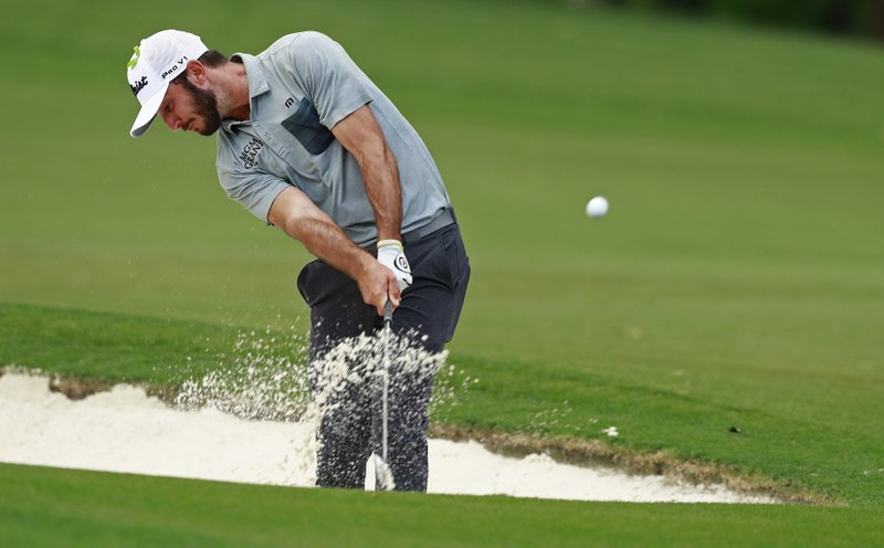 Max Homa hits from a sand trap on the 16th fairway during the final round of the Wells Fargo Championship golf tournament at Quail Hollow Club in Charlotte, N. (AP Photo/Jason E. Miczek)