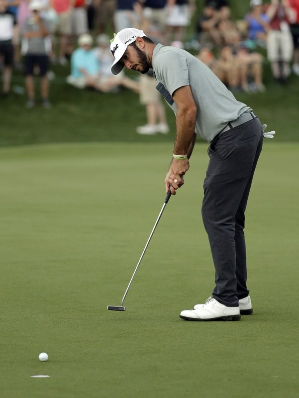 Max Homa watches his putt on the 18th hole en route to winning the Wells Fargo Championship golf tournament at Quail Hollow Club in Charlotte, N. (AP Photo/Chuck Burton)