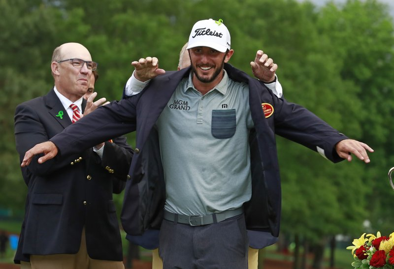 Max Homa receives his blazer after winning the Wells Fargo Championship golf tournament at Quail Hollow Club in Charlotte, N. (AP Photo/Jason E. Miczek)