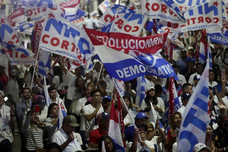 Supporters wait for Presidential candidate Laurentino Cortizo, with the Democratic Revolutionary Party, on election day in Panama City, Sunday, May 5, 2019. (AP Photo/Arnulfo Franco)
