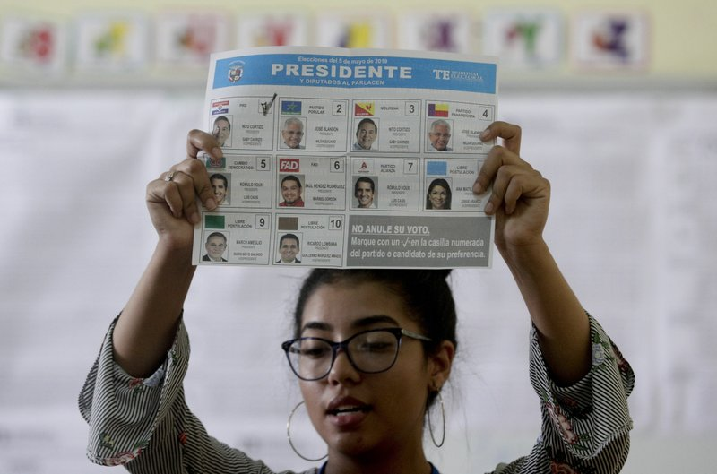 An electoral worker shows a ballot during a manual count after polling stations closed for the general election in Panama City, Sunday, May 5, 2019. (AP Photo/Arnulfo Franco)