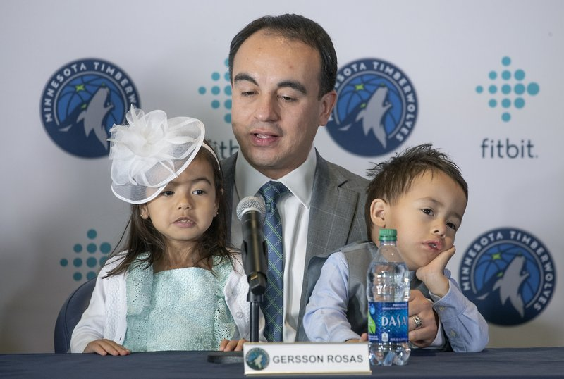 Minnesota Timberwolves NBA basketball team new president of basketball operations, Gersson Rosas, speaks during an introductory press conference with his 3-year-old twins Giana, left, and Grayson at the Target Center in Minneapolis, Monday, May 6, 2019. (Elizabeth Flores/Star Tribune via AP)