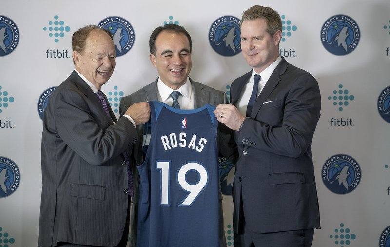 Minnesota Timberwolves owner Glen Taylor, left, new team President of basketball operations Gersson Rosas, center, and CEO Ethan Casson pose after a press conference introducing Rosas at the Target Center in Minneapolis, Monday, May 6, 2019. (Elizabeth Flores/Star Tribune via AP)