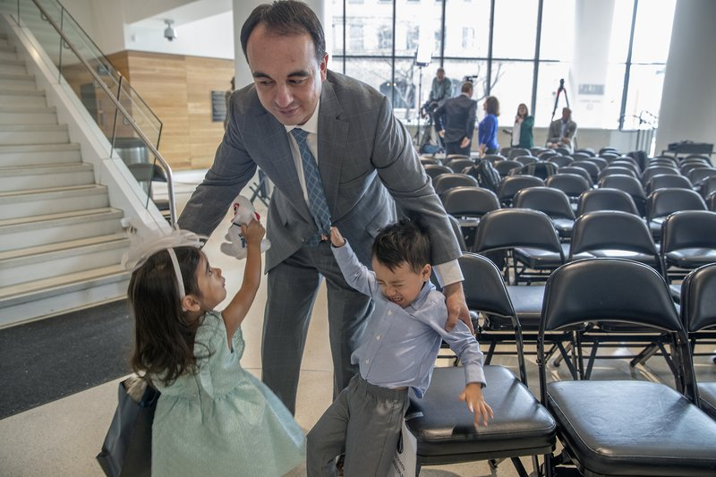 Minnesota Timberwolves NBA basketball team new president of basketball operations, Gersson Rosas, talks with his 3-year-old twins Giana, left, and Grayson, after an interview at the Target Center in Minneapolis, Monday, May 6, 2019. (Elizabeth Flores/Star Tribune via AP)