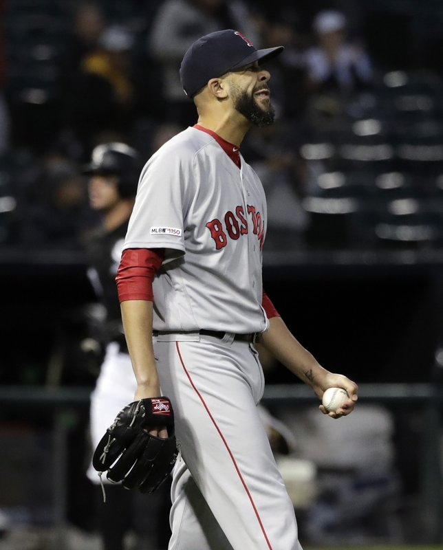 Boston Red Sox starting pitcher David Price reacts after Chicago White Sox's James McCann hit a two-run home run during the first inning of a baseball game in Chicago, Thursday, May 2, 2019. (AP Photo/Nam Y. Huh)