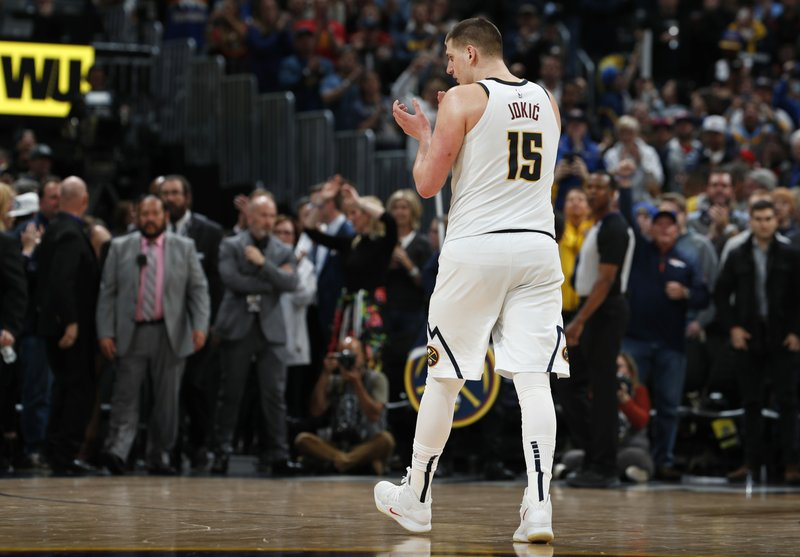 Denver Nuggets center Nikola Jokic claps as time runs out in the second half of Game 1 of an NBA basketball second-round playoff series against the Portland Trail Blazers, Monday, April 29, 2019, in Denver. (AP Photo/David Zalubowski)