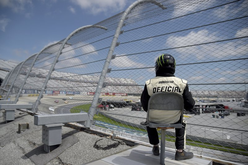 A NASCAR official looks on as drivers compete during the NASCAR Cup Series auto race, Monday, May 6, 2019, at Dover International Speedway in Dover, Del. (AP Photo/Will Newton)