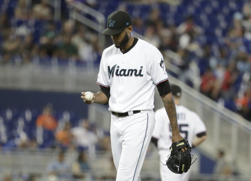 Miami Marlins relief pitcher Tayron Guerrero stands on the mound during the 10th inning after giving up two runs to the Atlanta Braves during a baseball game, Sunday, May 5, 2019, in Miami. (AP Photo/Lynne Sladky)