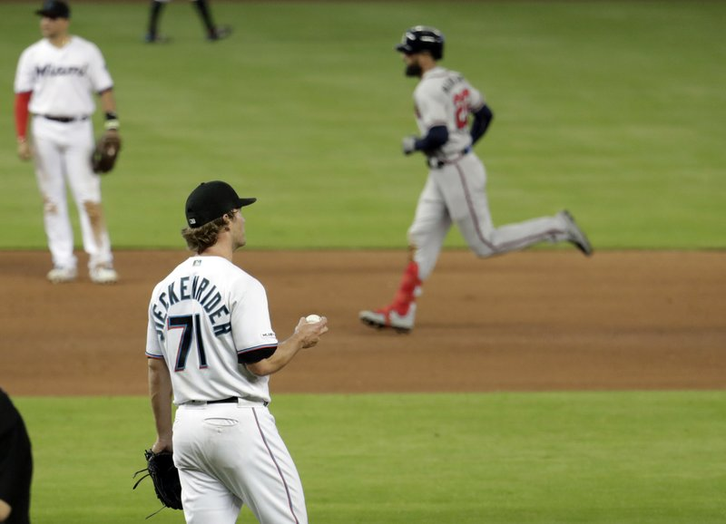 Miami Marlins relief pitcher Drew Steckenrider (71) watches as Atlanta Braves' Nick Markakis rounds the bases on a solo home run during the seventh inning of a baseball game, Sunday, May 5, 2019, in Miami. (AP Photo/Lynne Sladky)