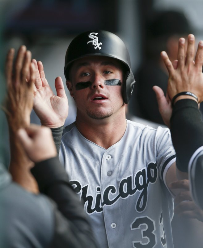 Chicago White Sox's James McCann celebrates in the dugout after scoring on a single by Tim Anderson off Cleveland Indians starting pitcher Trevor Bauer during the sixth inning of a baseball game, Monday, May 6, 2019, in Cleveland. (AP Photo/Ron Schwane)